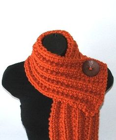 Sew a cute button to a scarf I already have.  Cozy.