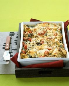 Lasagna with Sausage and Kale - Martha Stewart Recipes. Spicy sausage, kale, cherry tomatoes, and ricotta cheese make this lasagna a substantial meal. Instead of layering, the noodles are broken into pieces and mixed with the other ingredients before being spread into a baking dish and topped with Parmesan.