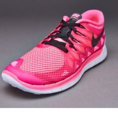 sale retailer 61843 4803c Nike Free 5.0 Women s, pink and black Lightly worn pair of bright pink  tennis shoes