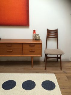 Mid century retro teak sideboard with single chair, west german pottery, rothko style orange painting and pappelina rug