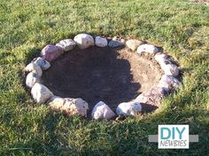 Very Simple Homemade Firepit- dig up dirt, rock border, done.... Maybe start like this for now??   I need to make our backyard firepit asap- for the Kiddos to have some fun nights ;-)