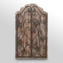 Reclaimed wood picket fence wall decor with an iron gate overlay. Product: Wall décorConstruction Material: Iron and woodColor: Distressed naturalDimensions: H x W x D Wrought Iron Decor, Wrought Iron Fences, Wood And Metal, Metal Walls, Metal Shutters, Indoor Shutters, Wood Picket Fence, Iron Furniture, Vintage Furniture