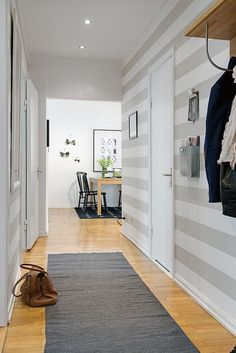 "The corridors can be, sometimes, complicated space to decorate. Too long, too narrow, too wide or too dark. It never ""rains to everyone's taste"" and t. Striped Hallway, Striped Walls, Striped Wallpaper Living Room, Corridor Design, Scandi Home, Hallway Designs, Hallway Ideas, Lets Stay Home, Hallway Decorating"
