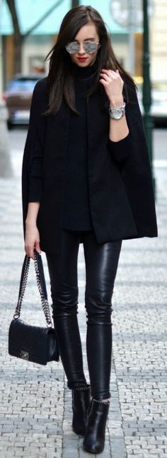 Barbora Ondrackova + all black + sleek and stylish outfit + leather leggings + black cape coat + minature black Chanel bag Cape: Missguided , Turtleneck: Proenza Schouler, Leggings: Balenciaga, Boots: Givenchy boots, Bag: Chanel.