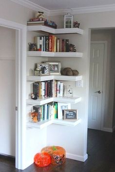 Put shelving in unused corners of the house to make the most of every last inch of space in your home. A great storage solution.