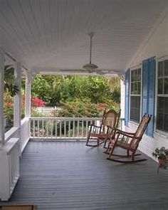 White front porch, two rocking chairs...the only thing missing is sweet tea with lemon, me, and a good book!