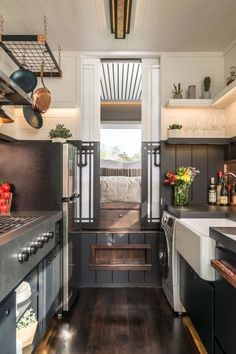 This is the Escher Tiny House on Wheels by New Frontier Tiny Homes. This house was designed and built to suit a couple with a baby (full time). It's an incredible custom tiny house built on a… (just for privacy doors) House Design, House, Small Spaces, Home, Small Room Design, House Built, House Interior, Home Kitchens, Tiny House Kitchen