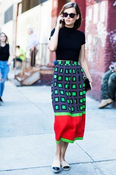 Take your officewear into the weekend by styling a midi skirt with a simple crop top.