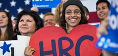 Learn more about Hillary's vision for America. Young girl holding HRC signage amidst a crowd of supporters at a Hillary Clinton rally.