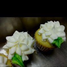 Vanilla cupcake with flower-