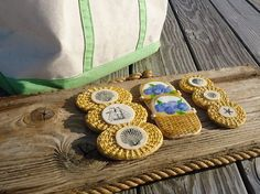 """Nantucket Basket """"lid"""" cookies with edible """"scrimshaw"""" and Nantucket baskets with painted hydrangeas are among our newest cookie designs."""