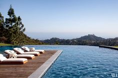 At Gisele Bündchen and Tom Brady's Los Angeles home, an infinity pool offers views of the city, with the Pacific Ocean in the distance.