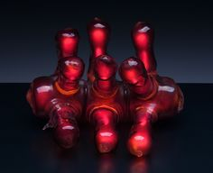"Eric Franklin, Vertebrae, flameworked borosilicate glass, neon, wood, 9"" x 11"" x 11"", 2003. Photo by Dan Kvitka."