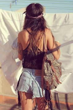 Short jean shorts, black bralet, black lace tank, leopard bag, scraggly hair, and a headband with tats. Yes.