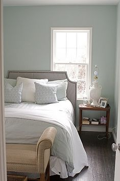 Benjamin Moore Woodlawn Blue love this wall colour with the white trim, white bedding, plush headboard, night side stable, lamp. Mmm perfectly rustic contemporary.