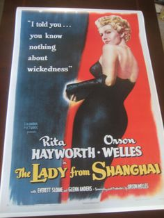 The Lady from Shanghai Movie Poster 24x36in , starring the Amazing Rita Hayworth (GodDamn Orson Welles made Her chop-off her beautiful, long , red hair !). Available from Shop of :  NathanHM , on Etsy.com (December 7th 2016)