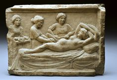 Plaque of a woman giving birth from Ostia Antica, now in London.