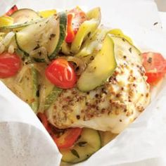 4 chicken breasts  2 tablespoons whole-grain mustard  2 small zucchini  2 sweet banana peppers cut into 1-inch pieces   2 shallots, thinly sliced  1 1/2 cups cherry tomatoes  4 teaspoons extra-virgin olive oil  1 tablespoon chopped fresh thyme  1/2 teaspoon salt  1/4 teaspoon ground pepper  Preheat oven to 400°F