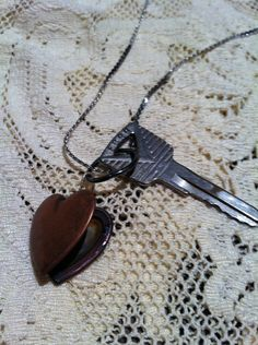 night at the drive in...Vintage necklace with old ford car key and heart shaped locket. cute. $14.00, via Etsy.