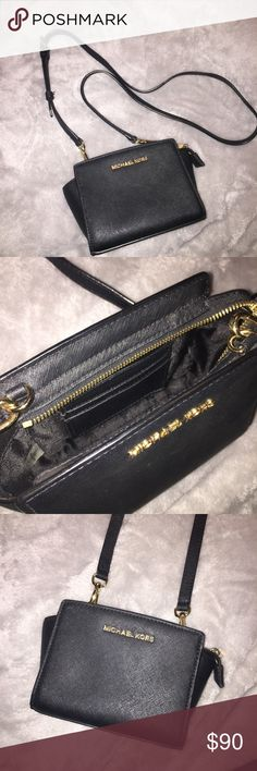 Michael Kors Mini Selma Michael Kors mini leather Selma with gold hardware and removable strap. Main compartment has zipper closure and has card holder pocket inside. Great mini bag and is very durable. In perfect condition. Michael Kors Bags Crossbody Bags
