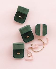 The bride gave her 'maids classic signet rings engraved with their initials, and her maid of honor received a bracelet. The packaging matched the day's pale-pink and green palette.