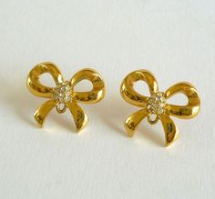 Gold Tone Bow Earrings with Rhinestones - $22