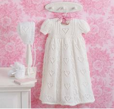 The darling christening layettes in Elegant Ensembles to Knit, Book 2 (Leisure Arts are the ultimate baby gifts. Each of the four sets designed by Judy Lamb includes an heirloom-quality gown, cap, and pair of booties. The sweet textures and p Knitting For Kids, Baby Knitting Patterns, Knitting Books, Baby Patterns, Dress Patterns, Blessing Dress, Knit Baby Dress, Baptism Gown, Gown Pattern