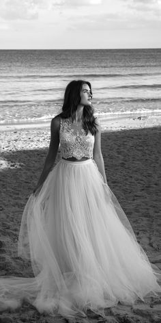 The perfect dress for a bohemian beach wedding. Gorgeous high cut, lace top with built-in bra and scoop neckline . The extra-long tulle skirt over mini slip envelops you in a cloud of soft tulle like