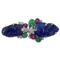 """Very fine and rare """"Tutti Frutti"""" platinum set double clip brooch, by Cartier circa 1920s-30s. The brooch is known as """"Tutti Frutti"""" because it resembles a fruit salad with the colorful combination of sapphires, rubies, emeralds and diamonds."""