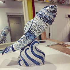 This is a ceramic fish painted in a delftware inspired design. It depicts the registration numbers of the Cadgwith Fishing boats, past and present. 100 of these fish, individually painted by various artists and celebrities, are to be auctioned in May in aid of the Fishermen's Mission Ceramic Fish, Sarah J, Various Artists, Fishing Boats, Screen Printing, Numbers, Objects, Blue And White