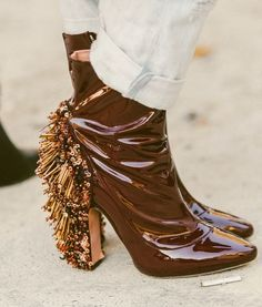 Super cool patent leather wine colored booties with tons of fringe detail embellishments. // More Fall Shoe Inspiration From The Best Street Style From Paris Fashion Week: (http://www.racked.com/2015/10/2/9439243/paris-fashion-week-street-style#4844732)
