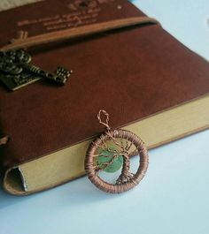 Amazing, unique, eye catching bonsai tree of life pendant necklace . Copper wire wrapped and natural shell moon