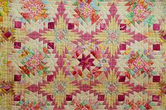 "Closeup of ""Start Again"" by Kimie Yanagisawa, shown at the Jan 2011 Tokyo Quilt Festival. Note how she uses large scale fabrics, cutting into small pieces to integrate into the overall patchwork pattern."