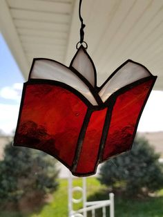Stained glass book ornament Deep red cover and smokey whote pages Perfect Christmas gift for any book lover Or for your own tree 4 inches tall -Comes with silver or black metal finish (Makes a great gift for teachers too!)