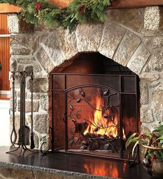 LOVE this stone fireplace surround - photo in Plow & Hearth Stone Fireplace Surround, Fireplace Mantle, Fireplace Ideas, Christmas Door Decorating Contest, Decorating Your Home, Decorating Ideas, Decor Ideas, Fireplace Screens, Light My Fire