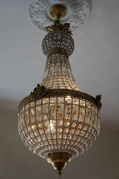 Antique brass chandelier www.hammer-and-heels.com