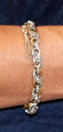 HM Queen Maxima's gold and diamond bracelet.
