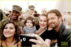 Gerard Butler Accepts Invite to Marine Corps Ball (Video): Photo #3590508. Gerard Butler puts his fists up while posing with marines at Camp Pendleton on Friday afternoon (February 26) in San Diego, Calif.    The 46-year-old actor visited…