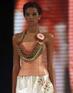 A model presents a creation inspired by native Indian culture by Colombian designer Bertha Henriquez during the Bollywood Pictures, Spanish Speaking Countries, Thirty Two, Textiles, Native Indian, How To Speak Spanish, Photo Galleries, Two By Two, Presents