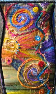 My 10 year old's favorite side up close... Machine needle felted dyed merino wool, Angelina fibers, & yarns with topstitching and decorative stitches.
