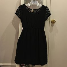 Cute Francesca's LBD Perfect condition size M LBD from Francesca's. Really comfortable fabric and the shape is super flattering with a cinched waist and non-clingy skirt. The top has a lacy polka dot pattern with bell sleeves and a see through back. Francesca's Collections Dresses