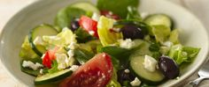 This classic Mediterranean salad bursts with the flavor of ripe olives, tangy feta cheese, crisp cucumbers and a tangy lemon dressing.