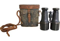 Brass Binoculars & Leather Case Moreau Paris brass binoculars with leather carrying case. Adjustable lens covers pull out to block glare.