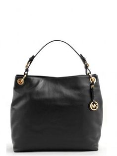 Michael Kors Jet Set Item black bag. Black leather bag from Micheal Kors, magnetic closure, one removable leather handle. The bag is fully lined in black fabric with embroidered logo. Inside a large pocket with zipper and three opened pockets. Michael Kors Fall Winter 2013-2014 Collection.