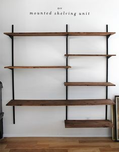 DIY shelving unit - SPRAY PAINT THE WALL BRACKETS GOLD... CLEAR COAT ON PINE FOR SHELVES...