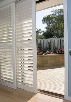 Shutters instead of curtains or dated vertical Blinds. Clever