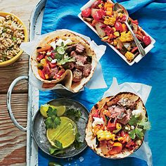 Steak Tacos with Charred Salsa | Try this fresh serving idea: Assemble and serve tortillas in parchment paper-lined cups. | SouthernLiving.com