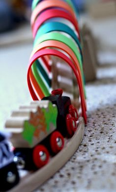 Might be time to haul out the wooden tracks!  Craft foam + double sided tape = fun tracks
