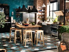 This kitchen is perfect. Industrial & rustic with quirky colorful undertones.