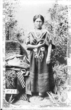 Navajo Woman in Native Dress with Concha Belt and Ornaments, Buffalo Robes? and Blanket Nearby - Randall - 1880